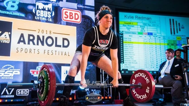 Kylie Redman, a 2017 Galion High School grad, attempts a lift at the 2018 Arnold Sports Festival.