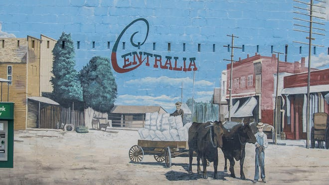 The mural depicting the history and culture of Centralia on the wall of Central Bank of Boone County's branch there. The mural must be destroyed because water damage is forcing replacement of the wall.