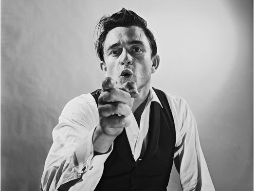 Country music's biggest personalities are captured in vintage and contemporary photos for 'Country: Portraits of an American Sound,' on view through Sept. 28 at the Annenberg Space for Photography in Los Angeles. This shot of Johnny Cash, taken at photographer Leigh Wiener's Hollywood studio on Aug. 3, 1960, is among more than 110 images.