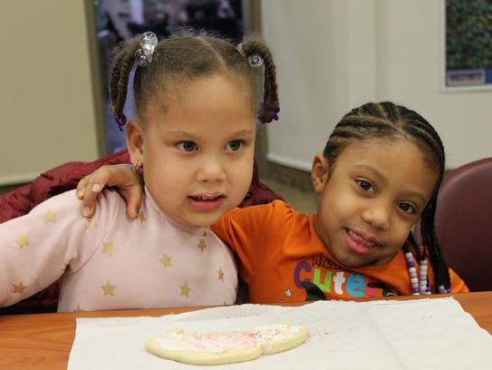 Friends, Autumn Boes, 3, left, and Mariah Jones, 6,