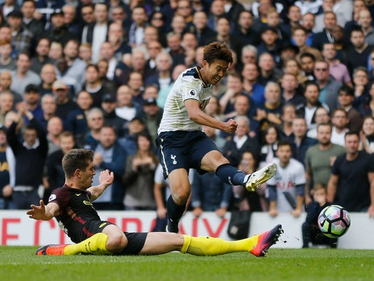 Tottenham Hotspur's Son Heung-min shoots at goal during the Premier League soccer match between Tottenham Hotspur and Manchester City at White Hart Lane stadium in London, Sunday, Oct. 2, 2016. (AP Photo/Frank Augstein)