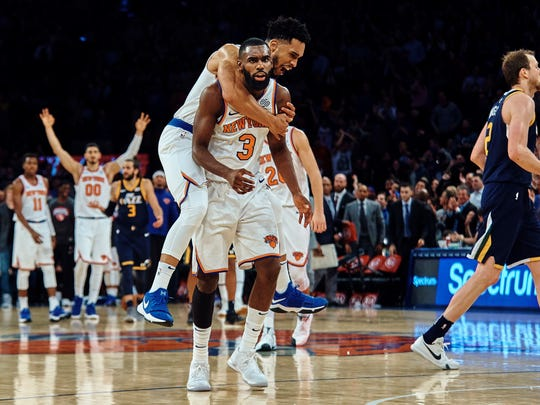 New York Knicks' Tim Hardaway Jr. (3) is congratulated by teammate Courtney Lee after scoring late in the fourth quarter against the Jazz.