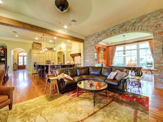 Gorgeous wood floors and brick arches are featured in the home.