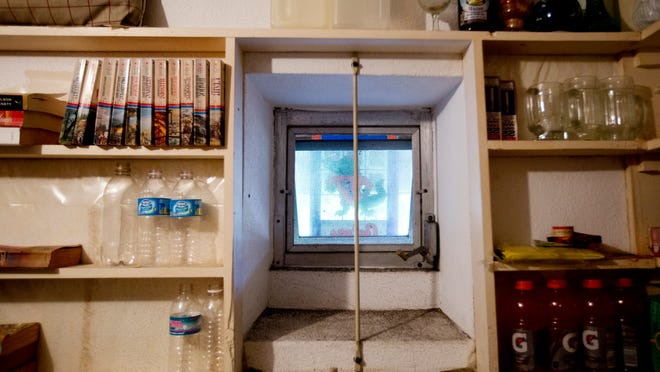 A fallout shelter built by Stanley and Edith Ink now serves as a storage room. He had it built in case of a nuclear bomb from the Cuban Missle Crisis.