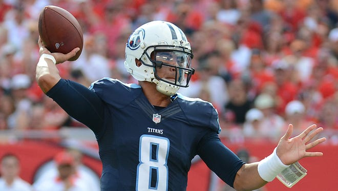 Tennessee Titans quarterback Marcus Mariota (8) throws a touchdown pass  in the first half against the Tampa Bay Buccaneers at Raymond James Stadium.