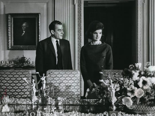 First lady Jacqueline Kennedy, accompanied by Charles Collingwood, shows the principal rooms of the White House in a TV special televised Feb. 14, 1962, on NBC and CBS.