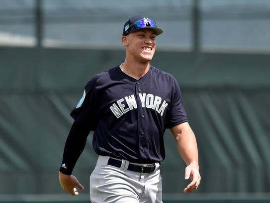 New York Yankees right fielder Aaron Judge (99) smiles