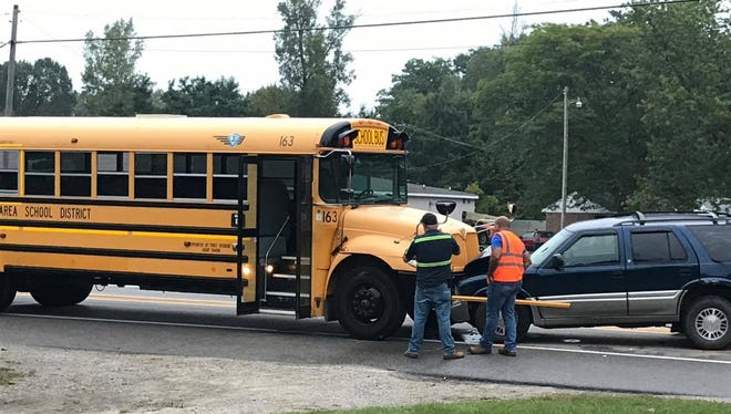No children were injured in a crash involving a school bus and two other vehicles.
