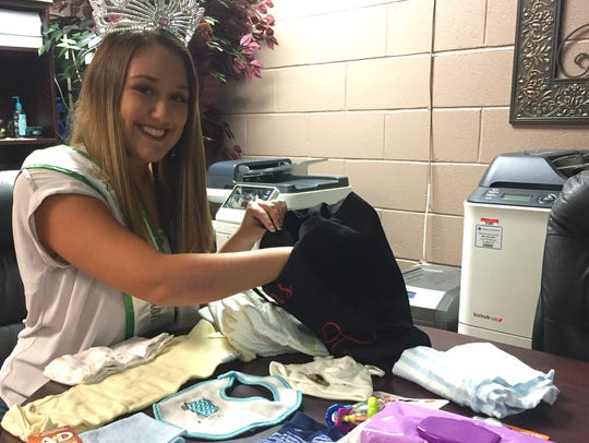 Miss Houston County Rebekkah Eaves unpacks a baby bag