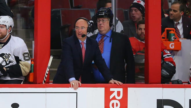 USA TODAY Sports NHL reporter Kevin Allen, right, stands with NBC announcer Pierre McGuire between the benches during the first period of a game between the Chicago Blackhawks and the Pittsburgh Penguins.
