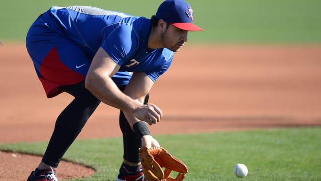 Texas Rangers third baseman Joey Gallo (13) fields a ground ball during a workout at Surprise Stadium Practice Fields.