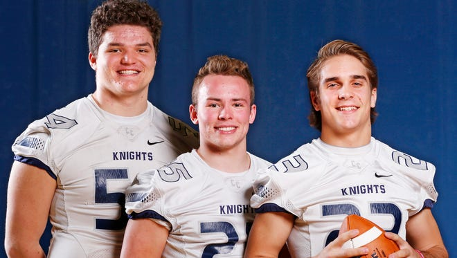 Central Catholic's Coy Cronk, from left, Brandon Yeagy and Jackson Anthrop are the 2015 Journal & Courier Small School Players of the Year for football.