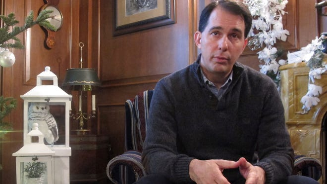 Wisconsin Gov. Scott Walker speaks during an interview with The Associated Press on Wednesday in the governor's mansion in Maple Bluff.