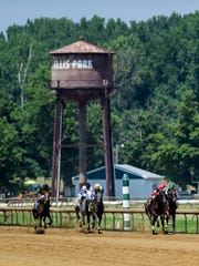 Jockeys close in on the finish line during the third race of the day at Ellis Park in Henderson, Ky., Friday afternoon, July 13, 2018.