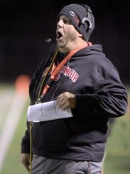 "Bennett coach Glenn ""Hoot"" Gibson reacts during his"