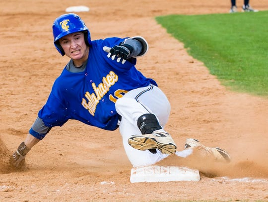 TCC's Mason Miller slides into third base during a