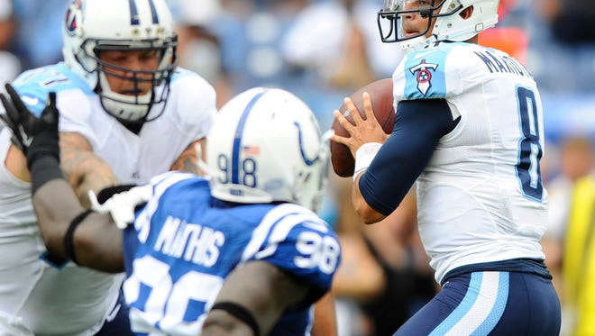 Titans quarterback Marcus Mariota (8) drops back to pass during the first half.