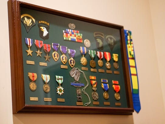 Three Purple Hearts are among the military service