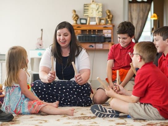 Suzanne Anderson works with her young students at the
