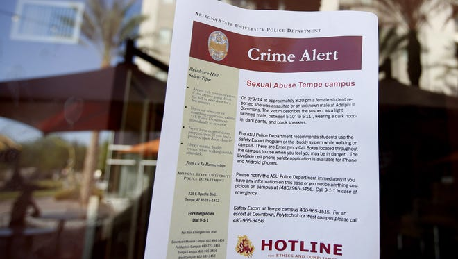 The Clery Act requires colleges to report crime statistics and also issue timely warnings on crimes that represent an ongoing threat. In this photo from 2014, ASU posts signs at Vista Del Sol near Apache Boulevard and Rural in Tempe after an sexual assault was reported at Adelphi II on Sept 9, 2014.