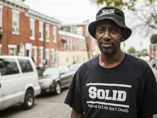 Francis Rogers poses for a portrait in the 400 block of N. Franklin St. in Wilmington on Tuesday afternoon. Rogers and his neighbors have restored peace to their block by calling each other to report crimes, instead of calling the police.