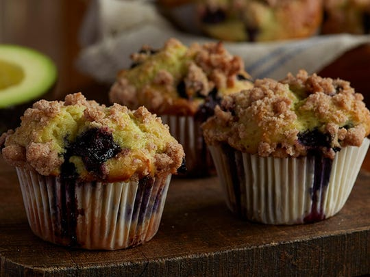 Using avocado, an effective fat substitute, creates soft, moist texture in baked goods like these avocado-blueberry muffins.