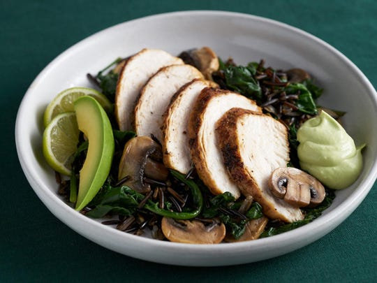Avocado, lime and sour cream sauce accompanies roast chicken bedded in wild rice, spinach and mushrooms.