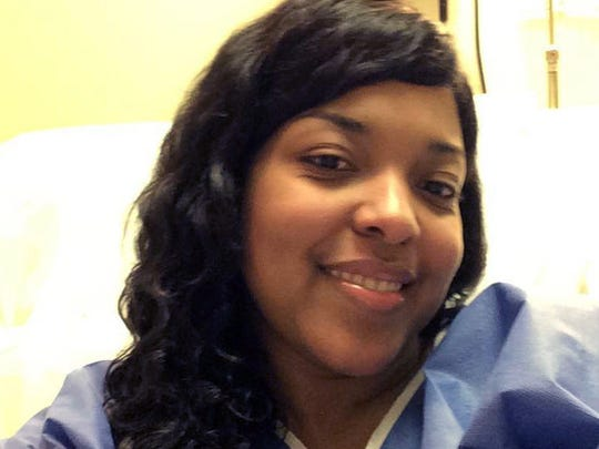 FILE - This Oct. 21, 2014, file photo, provided by Amber Vinson, shows Vinson at Emory University Hospital in Atlanta. Vinson, a Dallas nurse who was being treated for Ebola, will attend a news conference, Tuesday, Oct. 28, 2014, to discuss her discharge from the hospital after tests showed she's virus-free. (AP Photo/Amber Vinson, File)