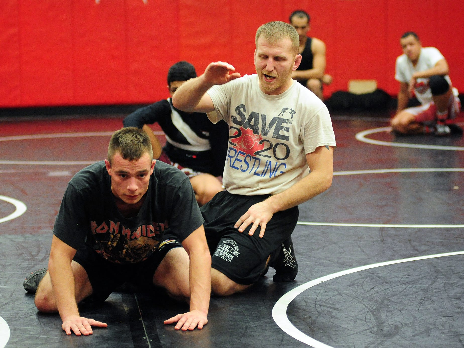 North Salem head wrestling coach Andy Pickett talks to his wrestlers during practice at the school on Monday, December 15, 2014.