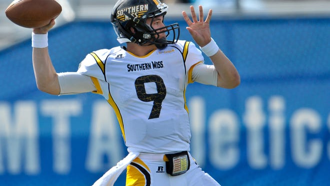 Oct 4, 2014; Murfreesboro, TN, USA; Southern Miss Golden Eagles quarterback Nick Mullens (9) throws the ball against the Middle Tennessee Blue Raiders during the second half at Floyd Stadium. The Blue Raiders won 37-31. Mandatory Credit: Jim Brown-USA TODAY Sports