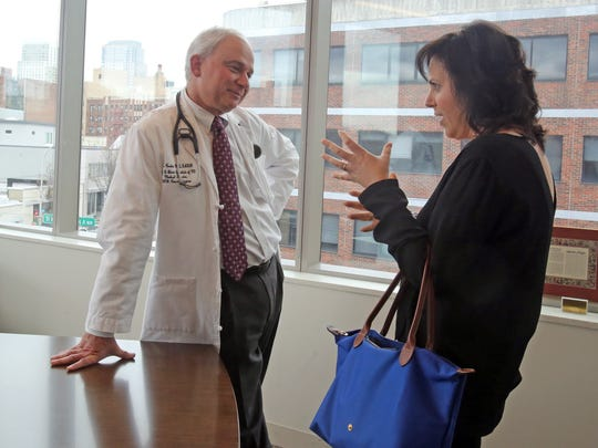 Lauren Kaufman. who is undergoing a clinical trial for an aggressive form of breast cancer was photographed with her doctor, Dr. Dan Costin at Dickstein Cancer Treatment Center in White Plains April 7, 2017.