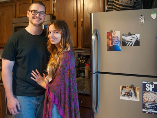 Amanda and Evan Longmore are shown in their Marlton kitchen. The couple filmed an episode of the popular HGTV show 'House Hunters' earlier this year. 'We always enjoyed watching the show,' said Amanda, who married Evan in November.
