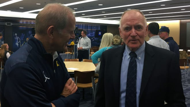 Michigan basketball coach John Beilein, left, and retiring U-M hockey coach Red Berenson talk after Berenson's announcement Monday in Ann Arbor.