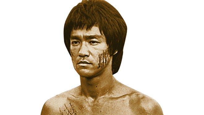 """Bruce Lee is shown in a scene from the 1973 film, """"Enter the Dragon,"""" completed shortly before his death of brain edema."""