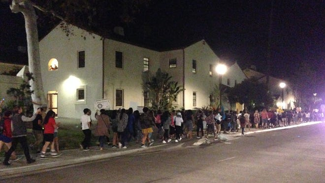 Students march through the CSU Channel Islands campus on Wednesday night to protest Donald Trump's election as president.