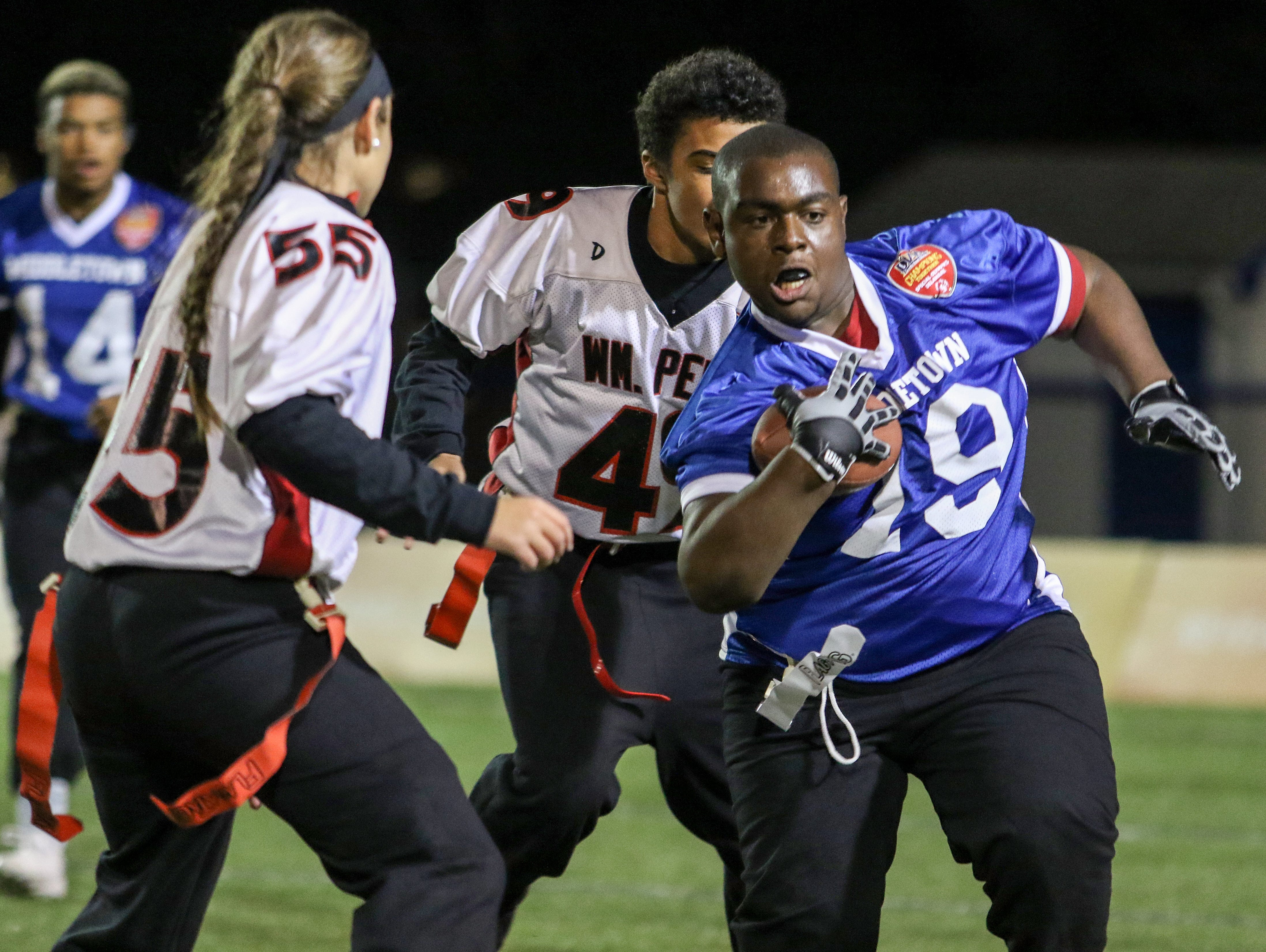 Middletown Unified athlete Davonte Bessix tries to escape the reach of William Penn athlete Nick Kane and partner Jessica Behornar.
