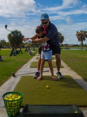 Paul Smith coaches his relative Michelle Smith, 8,