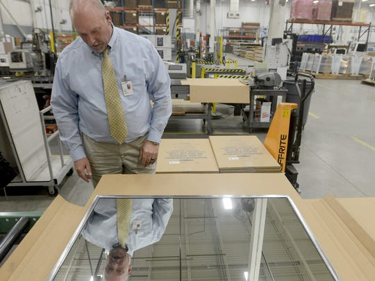 Jim Hudson shows the finished product of one of the items manufactured at Bobrick in Jackson.