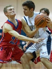 Ocean's Luke Yates defends as Middletown South's Nick