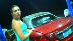 Taira L. Litsey, 31 of Louisville is seen next to a red 2002 Chrysler Sebring.
