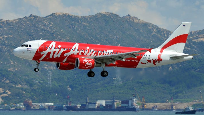 An AirAsia Airbus passenger plane lands at Hong Kong's