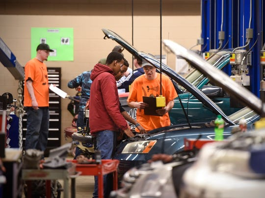 Students learn some basic auto repair tasks during a career day event Thursday, Feb. 9, at St. Cloud Technical & Community College in St. Cloud. Leaders in the automotive and trucking industries say they see a growing need for new talent.