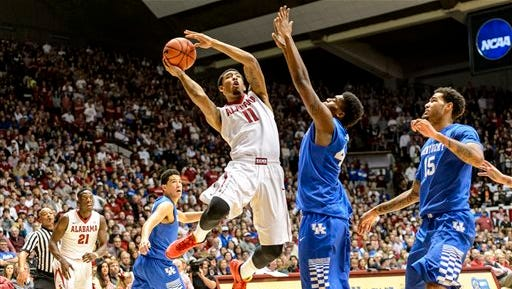 Alabama forward Shannon Hale (11) shoots as Kentucky center Dakari Johnson (44) defends during the second half during of an NCAA college basketball game, Saturday, Jan. 17, 2015, at Coleman Coliseum in Tuscaloosa, Ala. (AP Photo/AL.com, Vasha Hunt) MAGS OUT