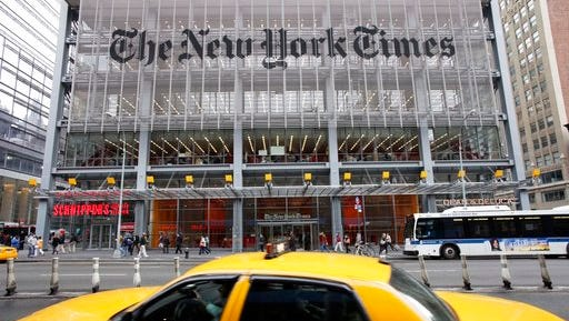 FILE - In this Tuesday, Oct. 18, 2011, file photo, traffic passes the New York Times building, in New York. The New York Times Co. reports financial earnings on Wednesday, May 3, 2017.