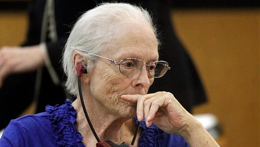 Alice Uden listens to the judge during jury selection at the Laramie County District Court in Cheyenne, Wyo. A judge sentenced Uden to life in prison on Monday for killing her husband with a rifle in the mid-1970s and throwing his body down the shaft of an abandoned gold mine, where it remained for nearly 40 years.