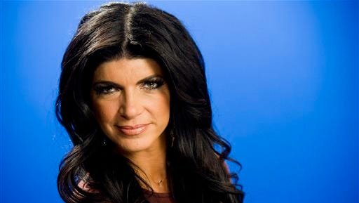 Teresa Giudice poses for a portrait in New York.  Giudice and her husband, Joe, are seeking nearly $4 million for their six-bedroom home in Montville, N.J. The couple are facing federal prison after they pleaded guilty to conspiracy to commit mail and wire fraud and three types of bankruptcy fraud.  The stone and stucco home was built in 2008 on a nearly 4-acre lot that includes a stream and a pond.