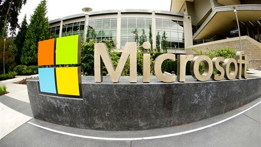 This file photo taken with a fisheye lens shows Microsoft Corp. signage outside the Microsoft Visitor Center in Redmond, Wash. Microsoft will acquire Stockholm-based game maker Mojang, the maker of the popular game Minecraft for $2.5 billion, the company announced today.