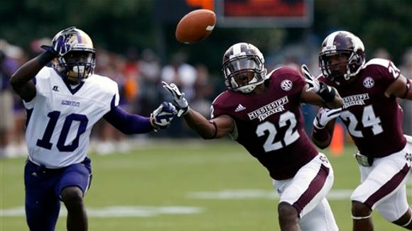 Mississippi State linebacker Matthew Wells (22) unsuccessfully tries to catch a blocked first-quarter pass-attempt by Alcorn State quarterback Zerick Rollins Jr. (10) during their NCAA college football game at Davis Wade Stadium, Saturday, Sept. 7, 2013, in Starkville, Miss. (AP Photo/Rogelio V. Solis)