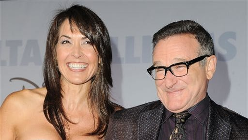 """This 2009 file photo shows actor Robin Williams and  his wife Susan Schneider at the premiere of """"Old Dogs"""" in Los Angeles. Williams, whose free-form comedy and adept impressions dazzled audiences for decades, died Monday in an apparent suicide. Williams was 63."""