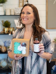 Jessica Lohan, owner of BellyBee Goods, holds some of her elderberry products.